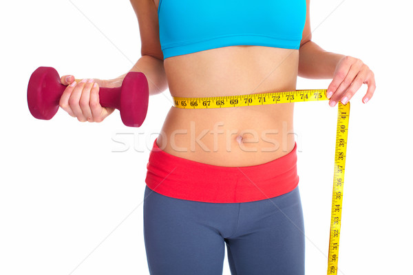 Stock photo: Beautiful healthy woman with a measuring tape.