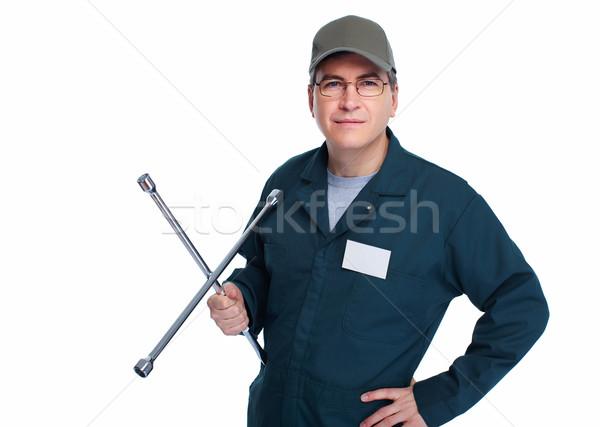 Auto mechanic with a wheel wrench. Stock photo © Kurhan