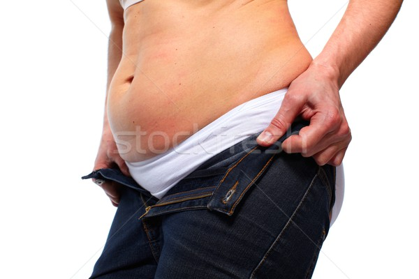 Stock photo: Woman with fat belly.