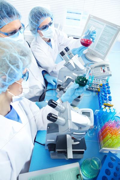 Stockfoto: Laboratorium · wetenschap · team · werken · vrouw · man