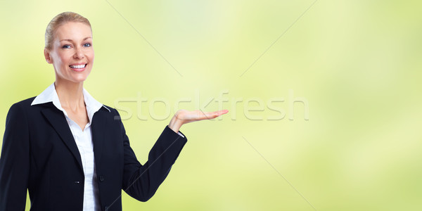 Stock photo: Beautiful business woman presenting copy space.