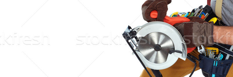 Builder handyman with electric saw. Stock photo © Kurhan
