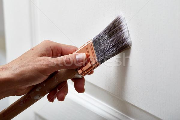 Hand with a paint brush. Stock photo © Kurhan