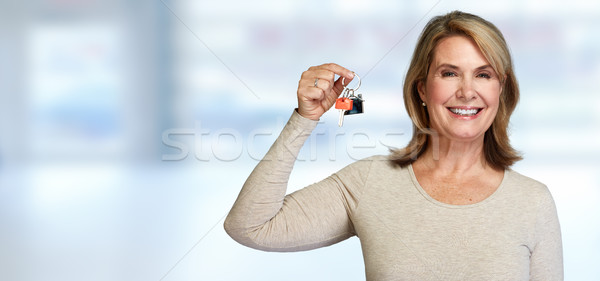 Senior realtor woman with key. Stock photo © Kurhan