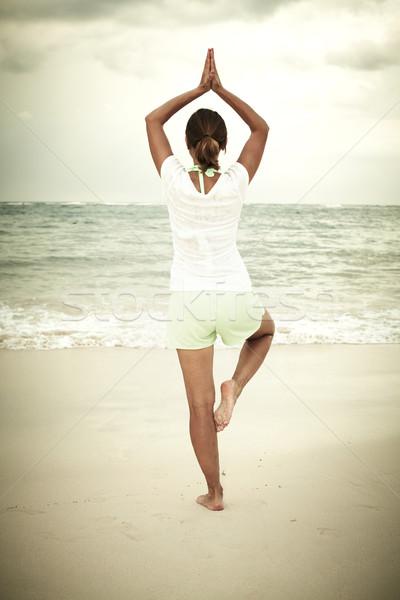 Woman doing yoga on Punta Cana beach. Stock photo © Kurhan