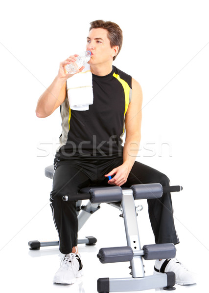 Smiling mature strong man working out. Isolated over white background Stock photo © Kurhan