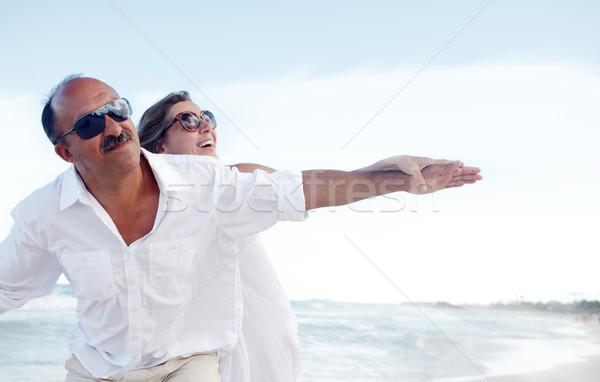 Happy couple on caribbean beach. Stock photo © Kurhan