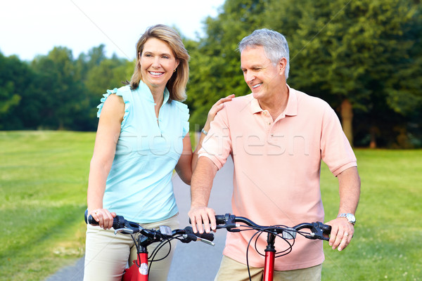 senior couple cycling Stock photo © Kurhan