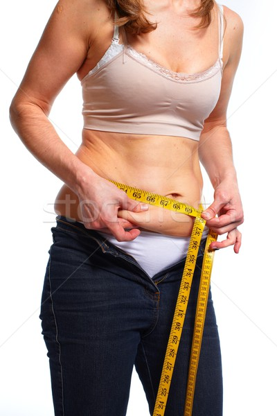 Woman measuring fat belly. Stock photo © Kurhan