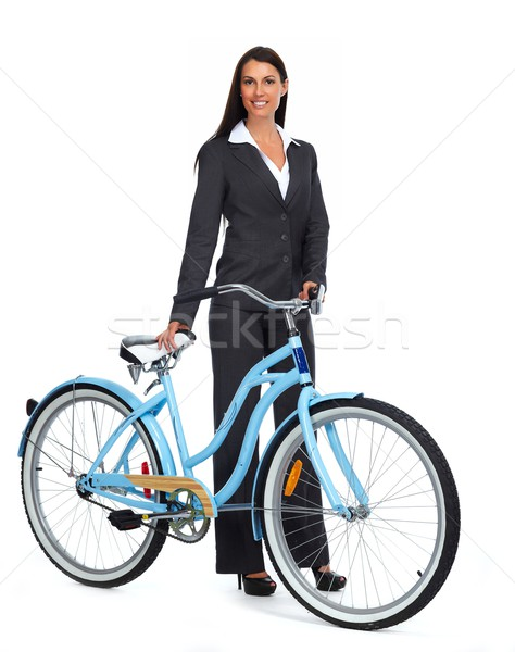 Stock photo: Business wiman with bicycle.