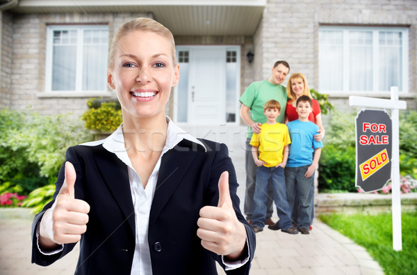 Real Estate agent woman near new house. Stock photo © Kurhan