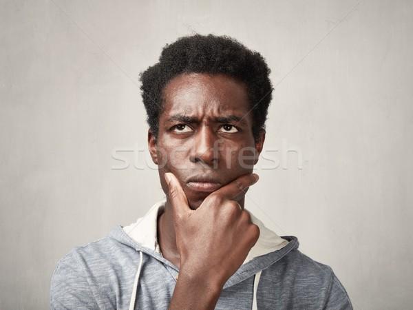 Gondolkodik férfi arc afroamerikai portré szürke Stock fotó © Kurhan
