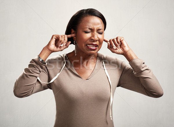 Black woman hearing anything Stock photo © Kurhan