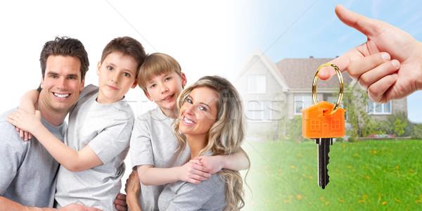 Family near new house Stock photo © Kurhan