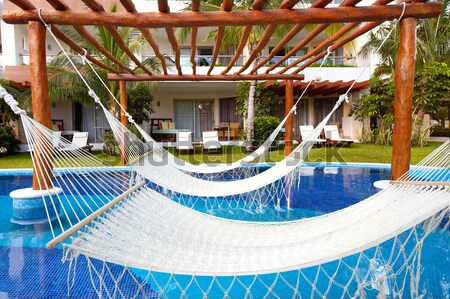 Zwembad hangmat luxe exotisch resort tuin Stockfoto © Kurhan