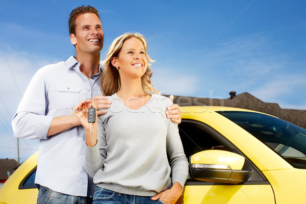 Stock photo: Couple with a new car key.