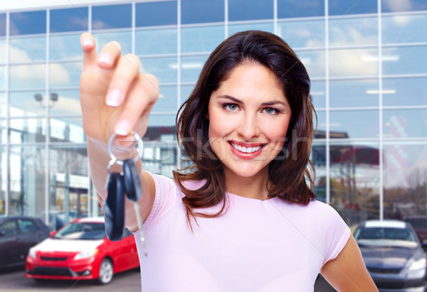 Beautiful woman with a car key. Stock photo © Kurhan