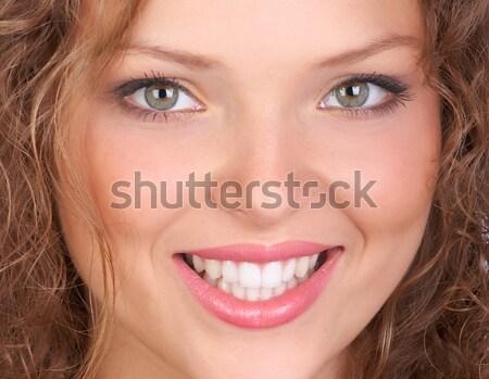 Gyönyörű mosolygó nő izolált fehér nő mosoly Stock fotó © Kurhan