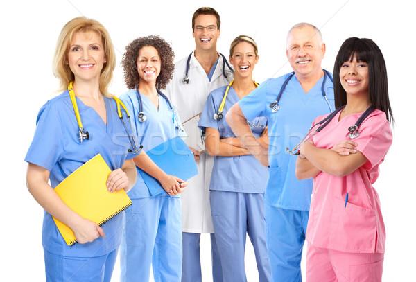 Médicos sorridente médico isolado branco trabalhar Foto stock © Kurhan