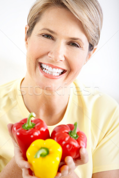 Stock photo: Woman with pepper