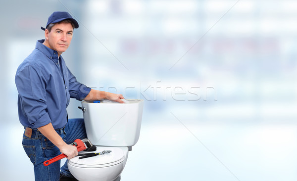 Plumber with toilet. Stock photo © Kurhan