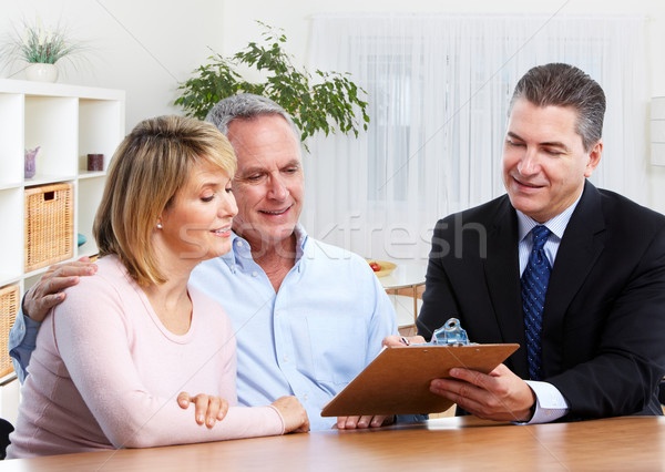 Senior couple with real estate agent. Stock photo © Kurhan