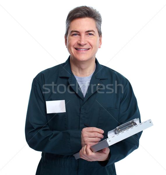 Uśmiechnięty hydraulik człowiek piśmie schowek przystojny Zdjęcia stock © Kurhan
