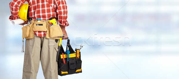 Hand of handyman with a tool bag. Stock photo © Kurhan