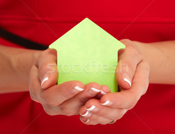 Hand with house sticky note. Stock photo © Kurhan