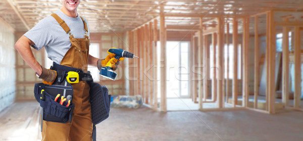 Construction worker with drill Stock photo © Kurhan
