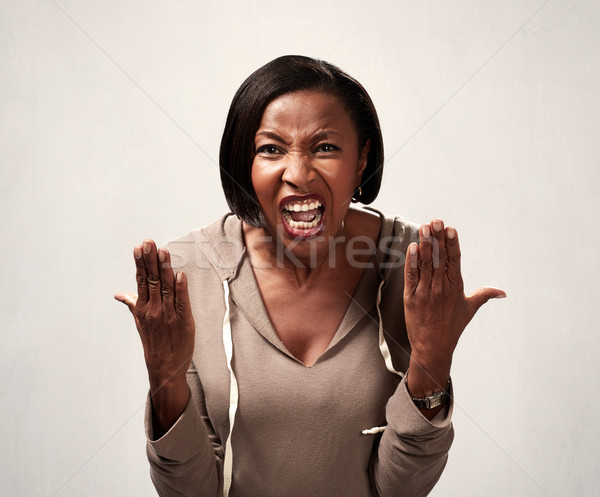 Angry african american woman Stock photo © Kurhan