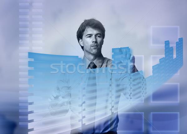 Businessman touching a holographic screen. Stock photo © Kurhan