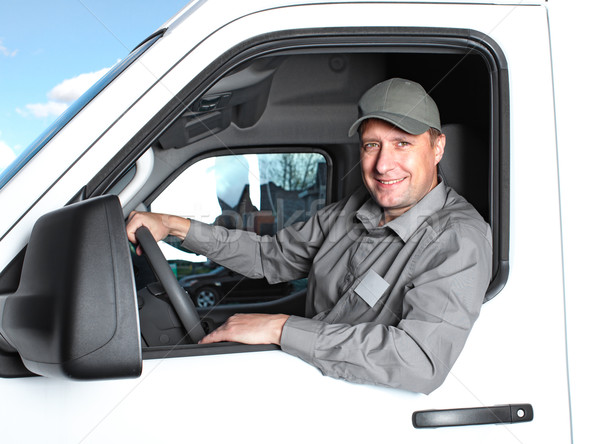 Jóképű teherautó sofőr mosolyog autó házhozszállítás Stock fotó © Kurhan