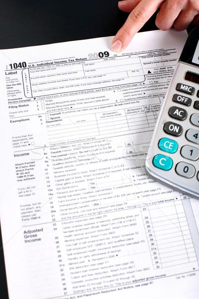 Stock photo: Income Tax Return and calculator