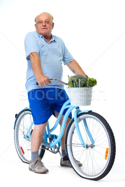 Elderly man with bicycle and vegetables. Stock photo © Kurhan