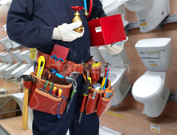 Encanador mãos torneira de água banheiro tigela casa Foto stock © Kurhan