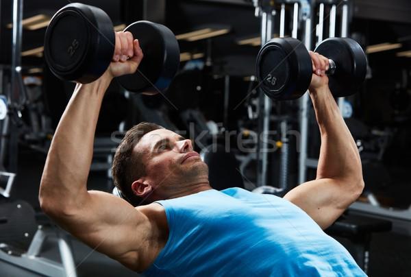 Gym bench press workout Stock photo © Kurhan