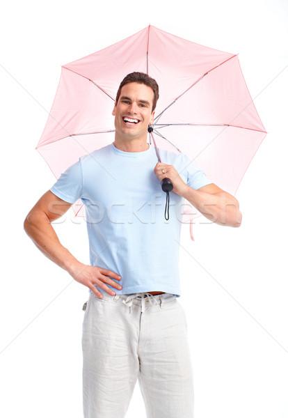 Boldog férfi fiatal esernyő izolált fehér Stock fotó © Kurhan