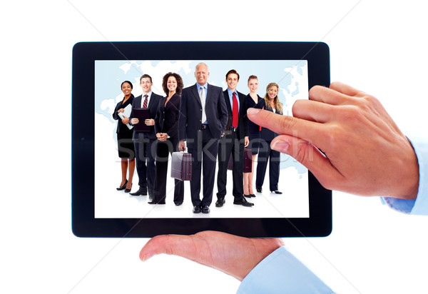 Tablet computer and group of business people. Stock photo © Kurhan