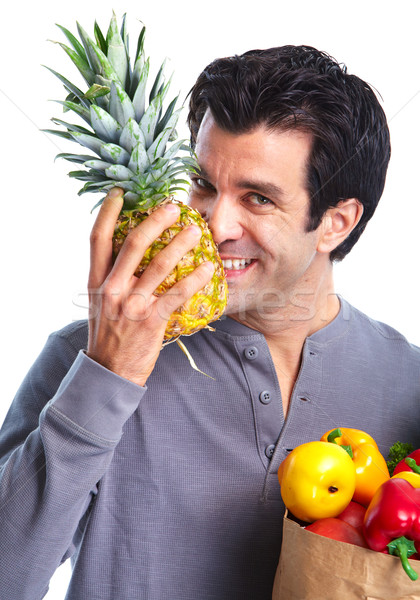 Man with a grocery bag and fruits. Stock photo © Kurhan