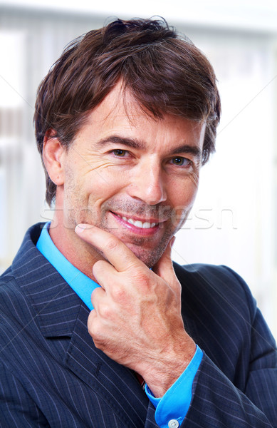 Ejecutivo empresario guapo gris negocios sonrisa Foto stock © Kurhan