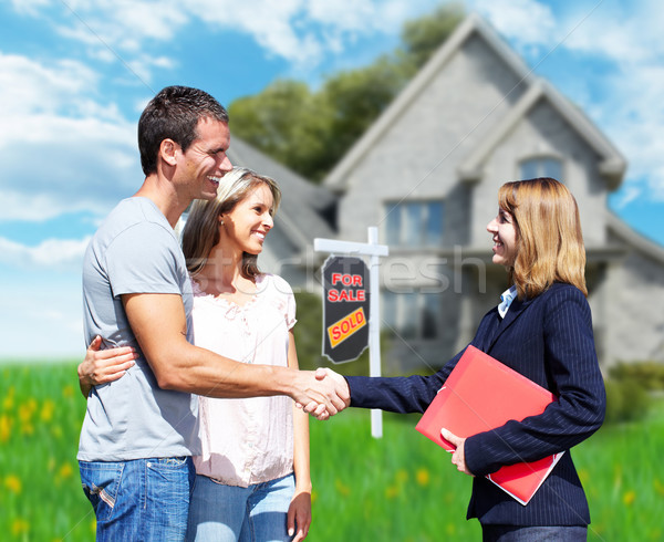 Family near new house. Stock photo © Kurhan