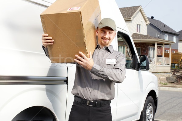 Postman with parcel near delivery truck. Stock photo © Kurhan