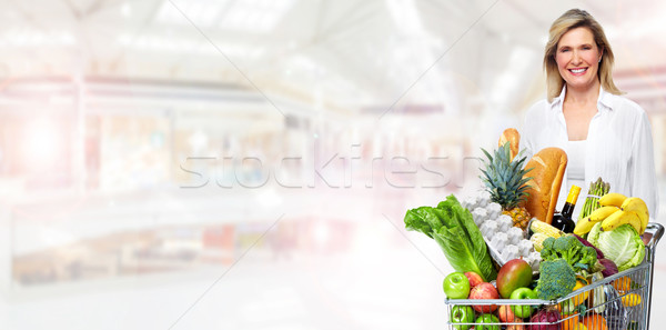 Beautiful senior woman with grocery shopping cart. Stock photo © Kurhan
