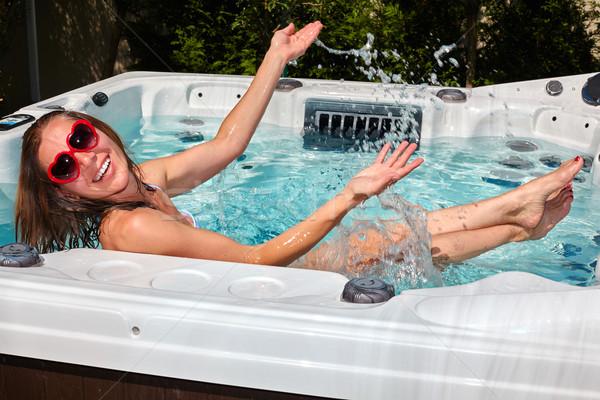 Feliz mulher relaxante banheira de hidromassagem jovem bela mulher Foto stock © Kurhan