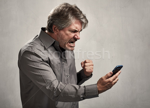 Stock photo: Angry Man with cellphone