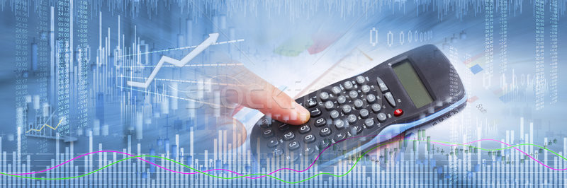 Investor hand with calculator Stock photo © Kurhan
