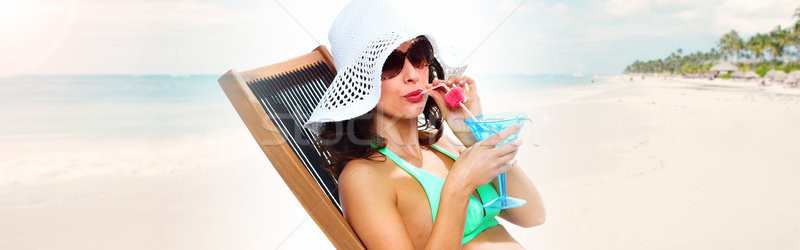 Woman sunbathing on the beach Stock photo © Kurhan