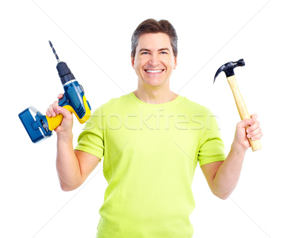 Man with hammer and drill. Stock photo © Kurhan