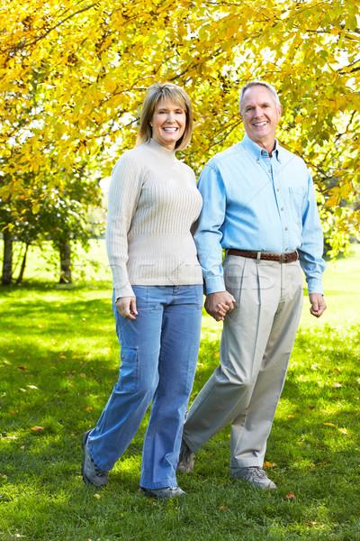 Feliz casal de idosos caminhada parque mulher amor Foto stock © Kurhan